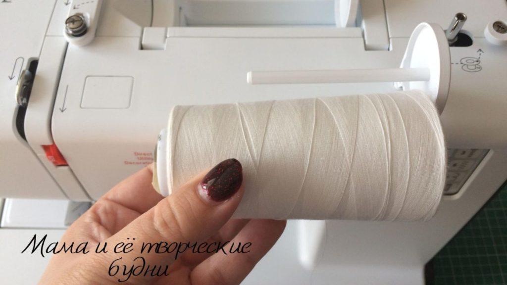 Катушечный стержень на бытовой швейной машине